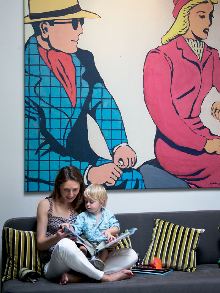 Monique Tollgard and child with big painting on wall behind