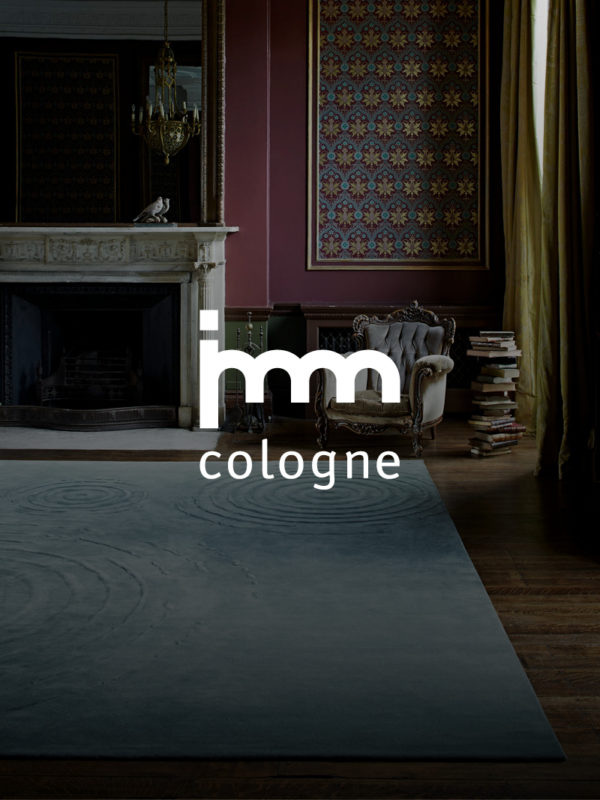 promotional photo for imm Cologne fair of traditional chair and fire place