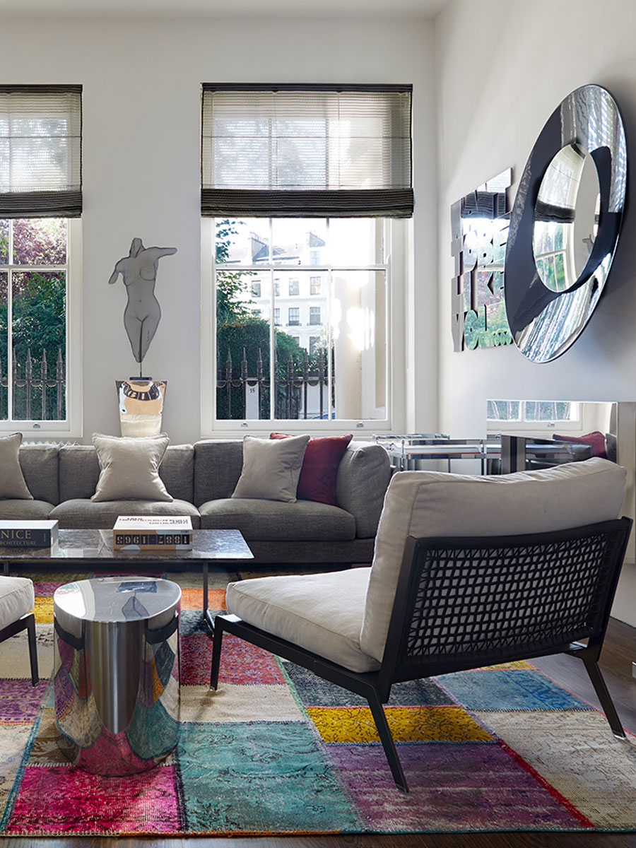 Living Room designed by Tollgard Design Group with colourful patchwork rug