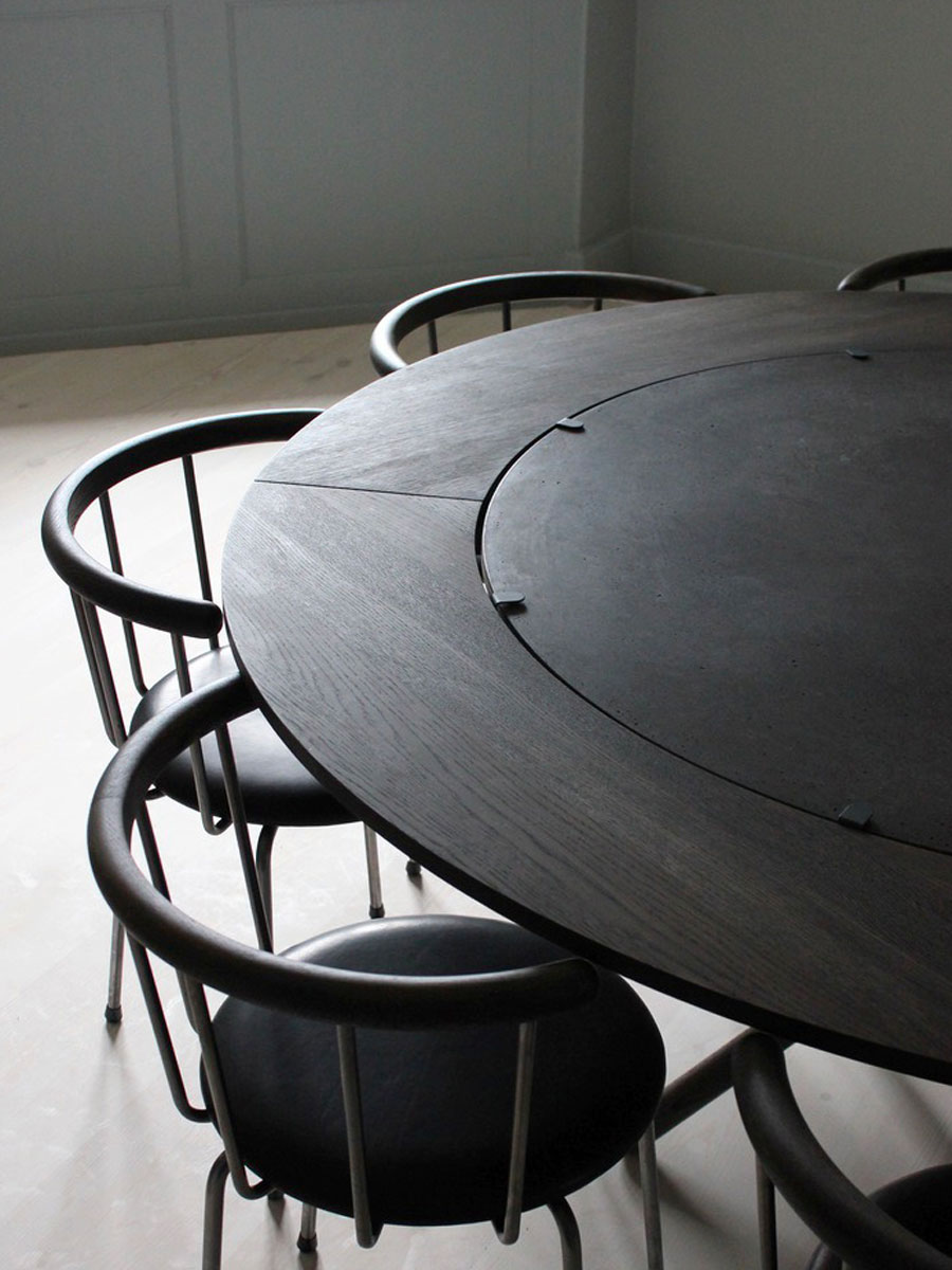 Eberhart's round Hector Dining Table and Hector Extra leaves in black oiled oak with BABETTE dining chairs in situ image
