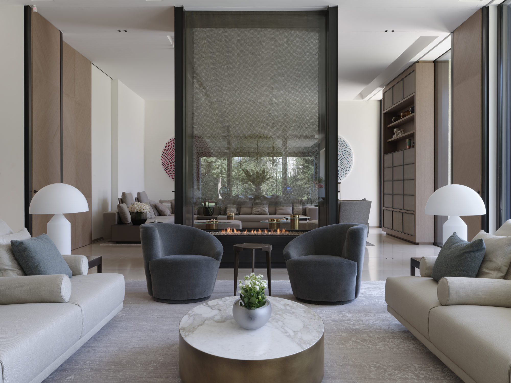 jordanian villa, amman villa, spatious living room in neutral tones and marble and brass coffee tables and oluce table lamps. designed by tollgard design group