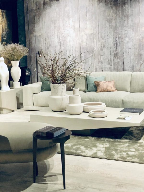 Tollgard showroom living room set up with sofas and coffee table