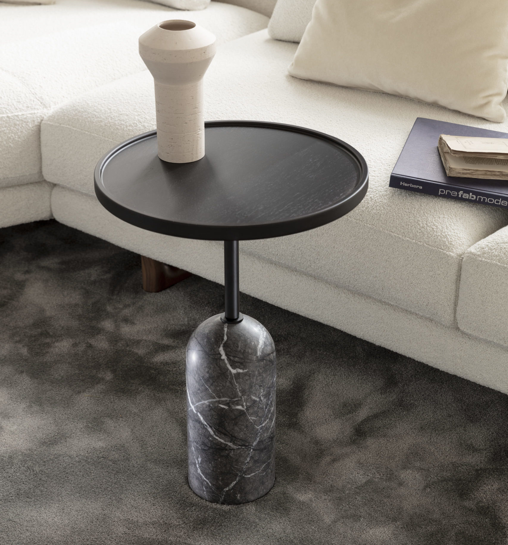 Ekero round side table by Porada with grey carnico base and black wooden top - white background
