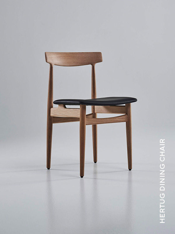 Eikund Hertug dining chair on oak and black leather upholstery in white background