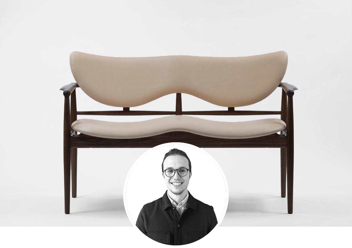 Finn Juhl 48 Sofa Bench upholstered in white leather in white background