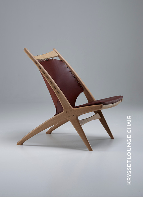 Eikund Krysset lounge chair with white oiled oak and brown leather in white background