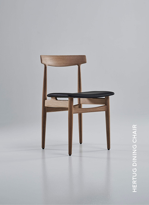 Eikund Hertug Dining Chair in oiled oak frame and black leather upholstery in white background