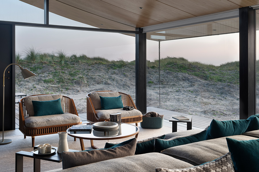 Tollgard Design Group living romm at modern danish summer house with glass walls and beach view