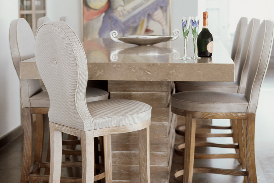 Marble Dining table with upholstered white textured dining chairs