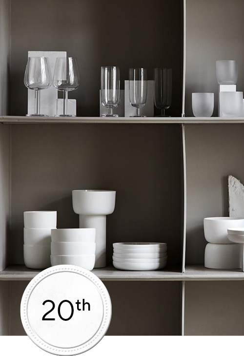 Glass ware and white ceremic collection on a cabinet
